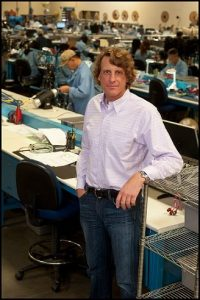 Dave Cianciulli, president of DC Electronics, on the company's shop floor.